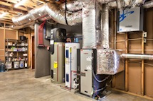 Picture of Bosch, geothermal, ground source heat pump equipment inside mechanical room.