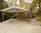 Contemporary carport with attached storage room picture